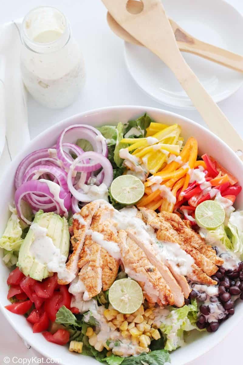 overhead view of chicken fajita salad with creamy salsa verde dressing