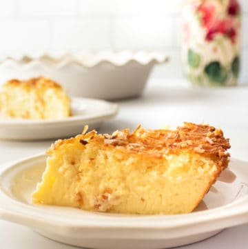 a slice of coconut custard pie on a plate