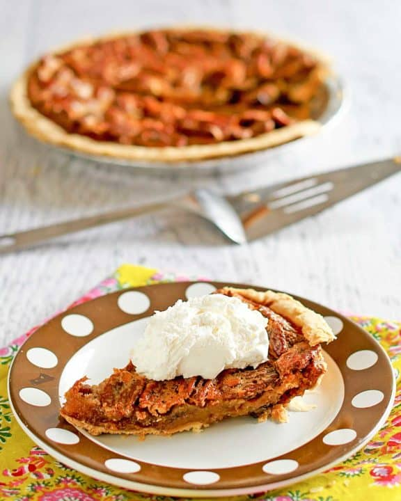 a slice of chocolate pecan pie on a plate