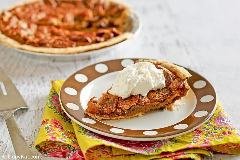 a slice of homemade Cracker Barrel chocolate pecan pie on a plate