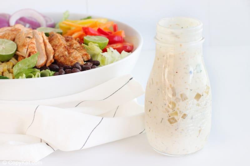 creamy salsa verde salad dressing and a chicken fajita salad