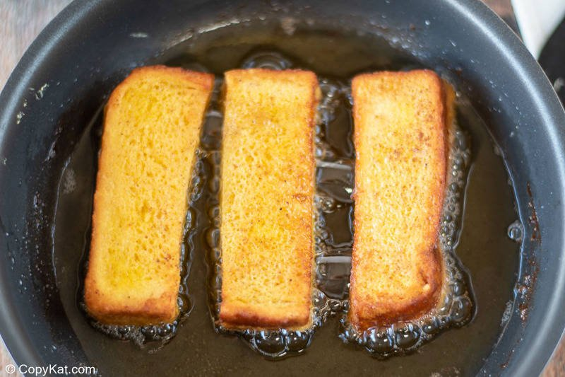 fried French toast sticks in a skillet