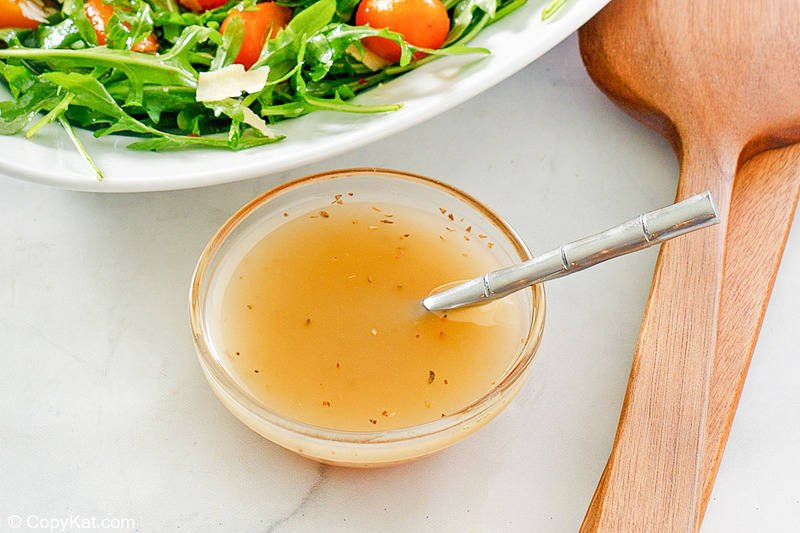 homemade Italian dressing and a spoon in a small bowl