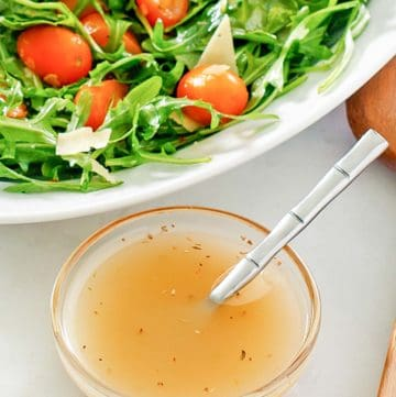 small bowl of homemade Italian dressing and a salad