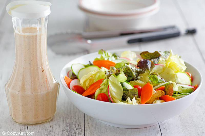 a bottle of homemade Houston's buttermilk garlic dressing and a salad