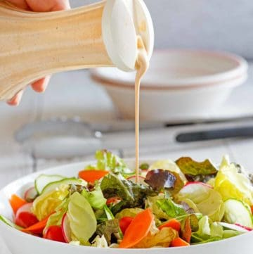 homemade Houston's Buttermilk Garlic Salad Dressing and a salad