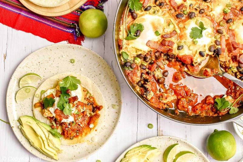 huevos rancheros on a plate and in a pan
