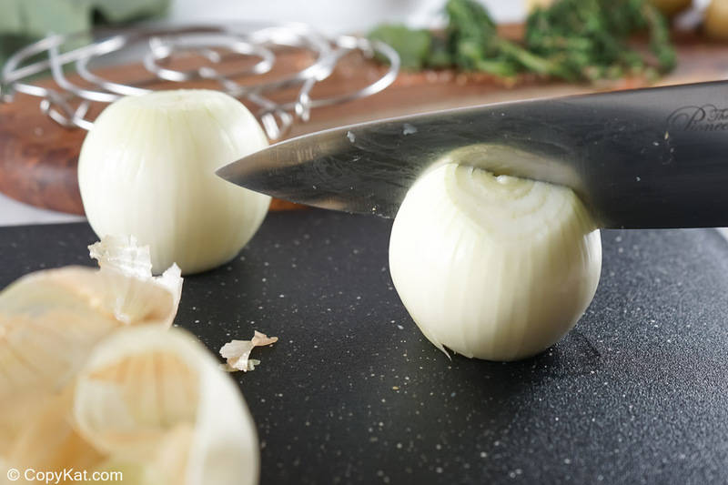 cutting an onion in half