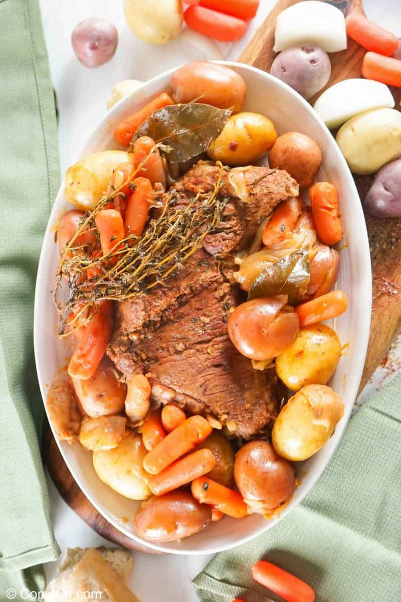 overhead view of Instant Pot tri tip roast and vegetables on a large platter