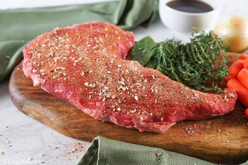 seasoned tri tip roast on a cutting board
