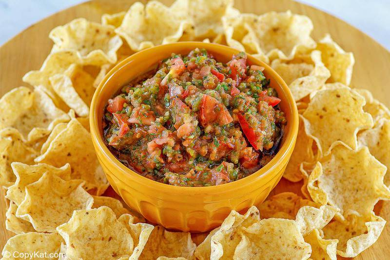 a bowl of homemade Pappasito's salsa and tortilla chips on a platter