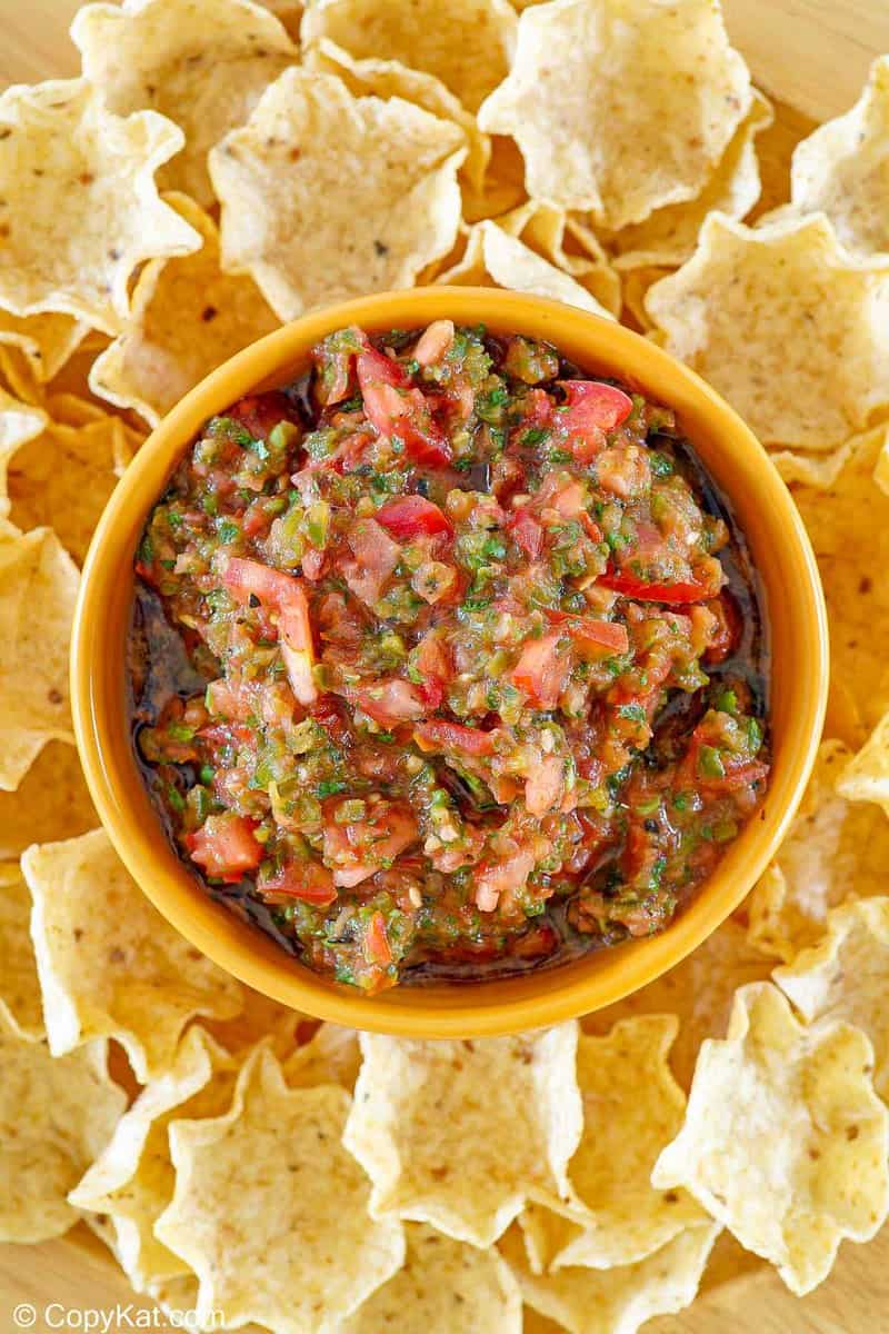 overhead view of homemade Pappasito's salsa in a bowl and tortilla chips