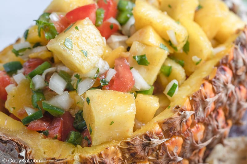 closeup of pineapple mango salsa in a pineapple