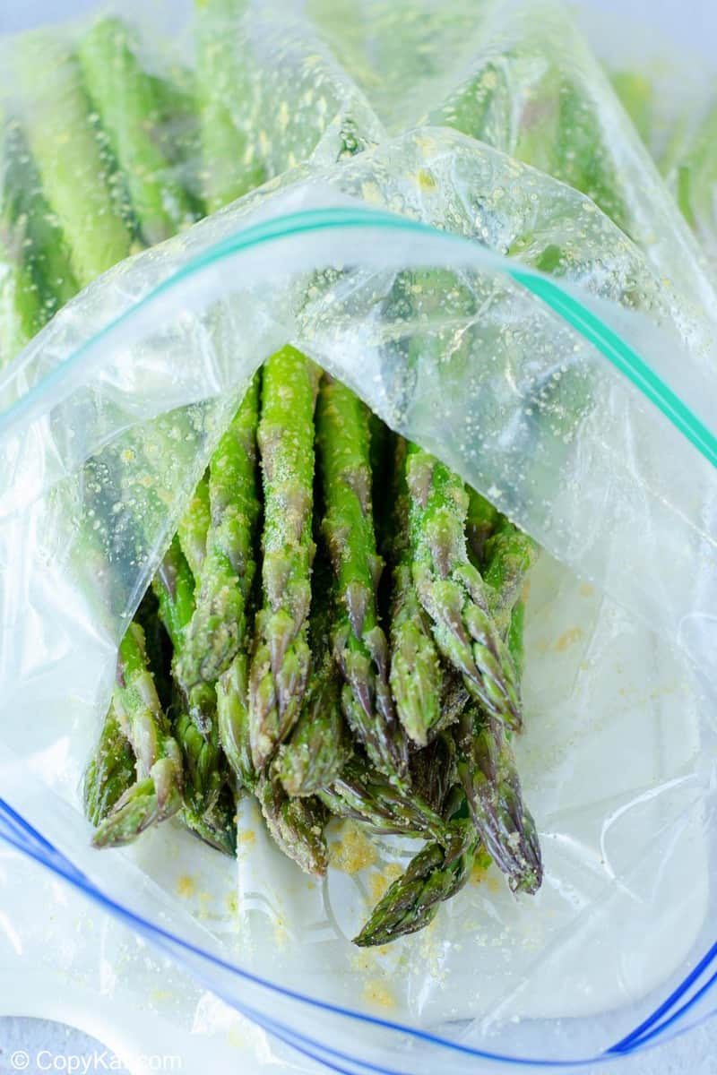seasoned asparagus in a zip-top bag