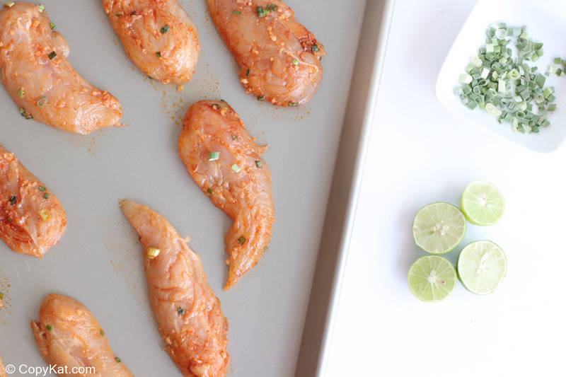fajita seasoned chicken tenderloins on a sheet pan