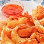 a plate of crispy battered shrimp
