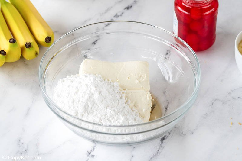banana split cake cream cheese layer ingredients in a bowl