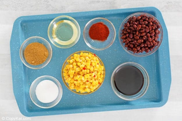 black bean and corn salad ingredients on a tray
