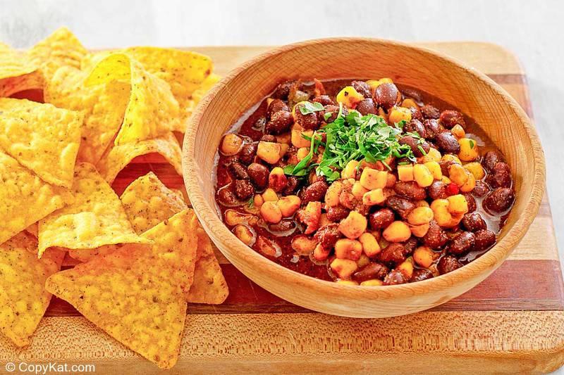 tortilla chips and a bowl of black bean and corn salad