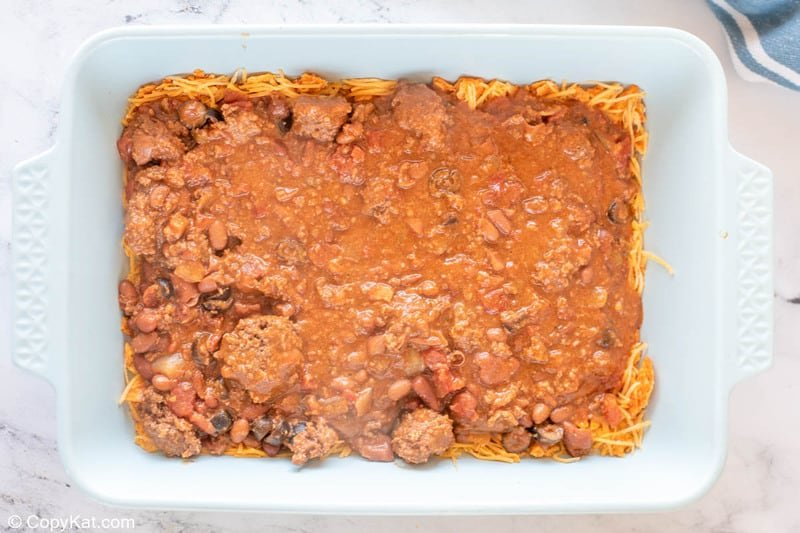 first meat and bean layer in Dorito casserole