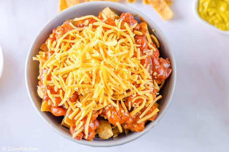a bowl of Fritos topped with chili and cheese