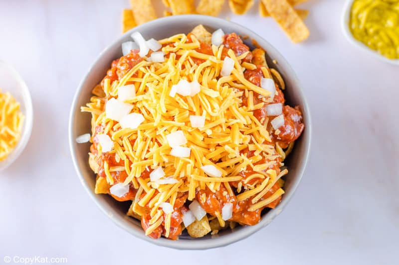 Frito pie with onions sprinkled on top