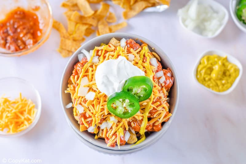 Frito pie and various toppings for it