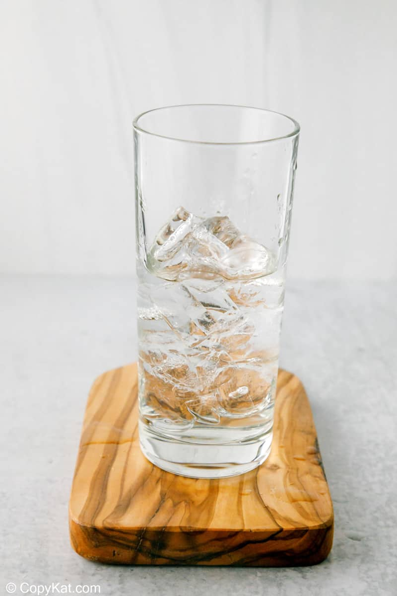 ice and peach schnapps in a glass