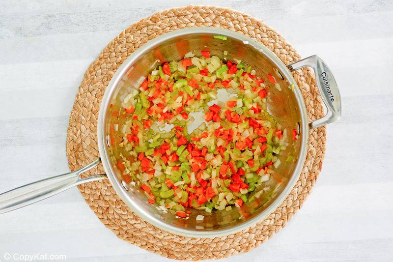 chopped onions, celery, and carrots in a pot