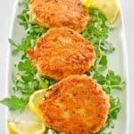 three salmon patties on a platter