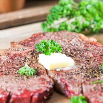 smoked steak topped with butter and parsley