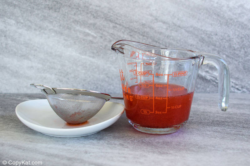 juice from frozen strawberries in syrup in a measuring cup