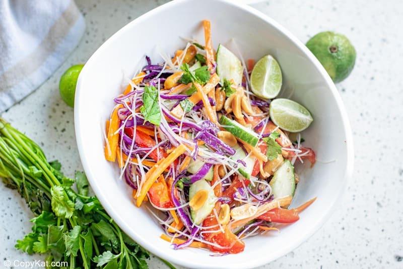 Thai noodle salad, limes, and fresh cilantro