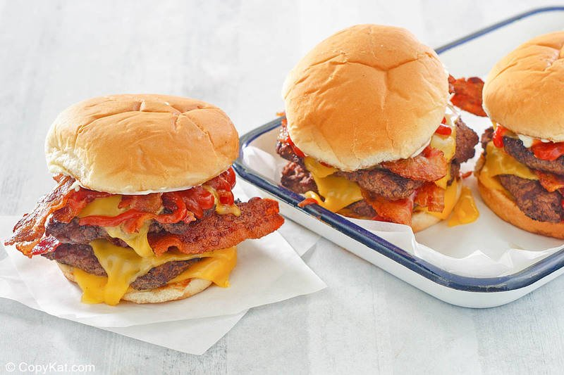 homemade Wendy's baconator burgers on parchment paper