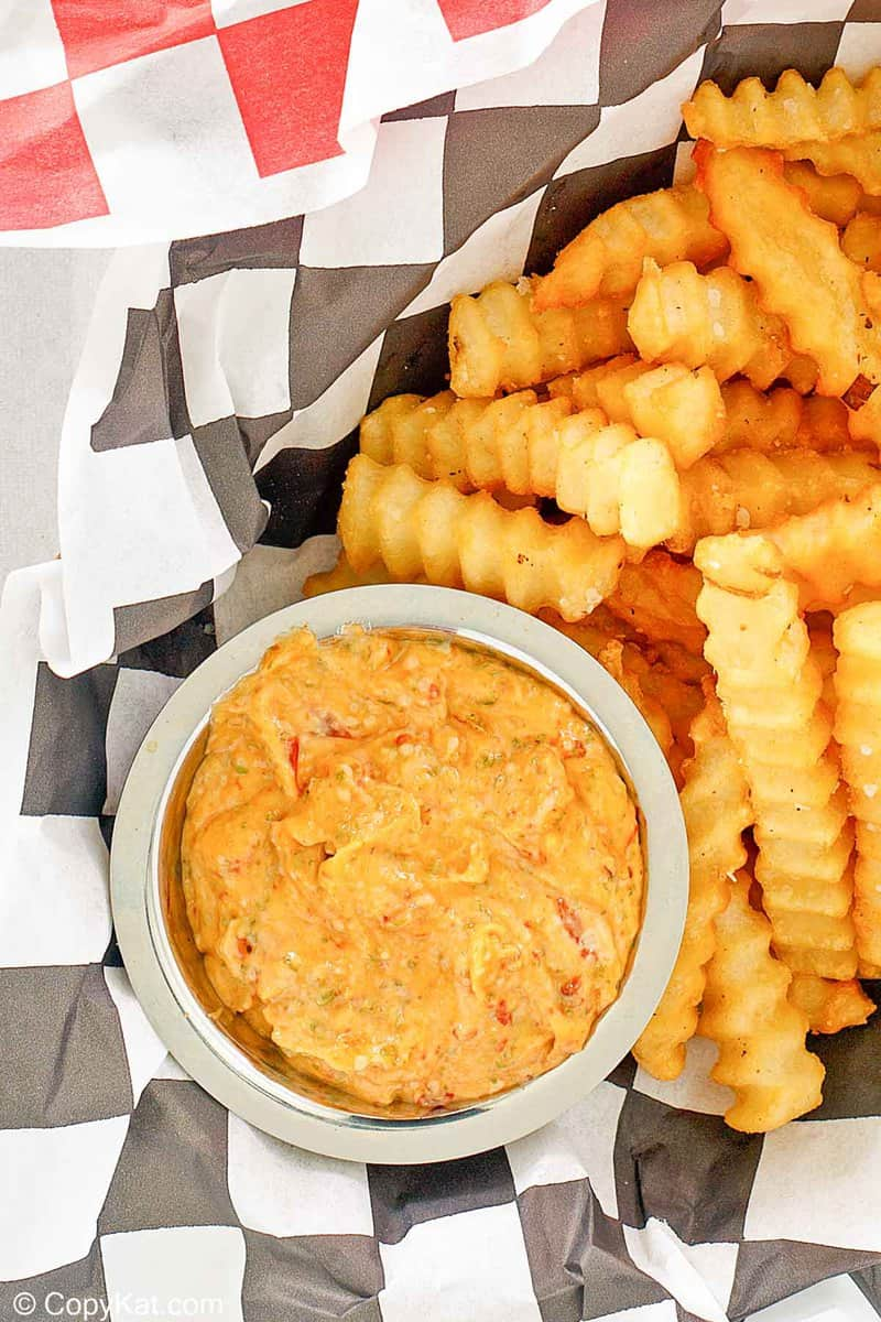 overhead view of a bowl of homemade Whataburger creamy pepper sauce and fries