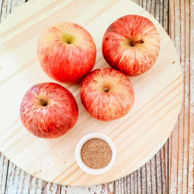 four apples and cinnamon sugar