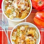 overhead view of two bowls of Bisquick apple cobbler, apples, and forks