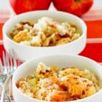 two bowls of Bisquick apple cobbler and two apples