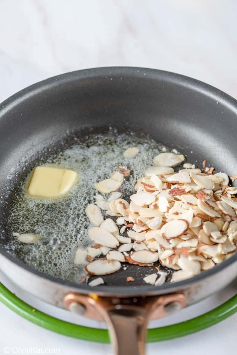 butter and sliced almonds in a skillet