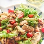 chicken Caesar salad in a colorful bowl
