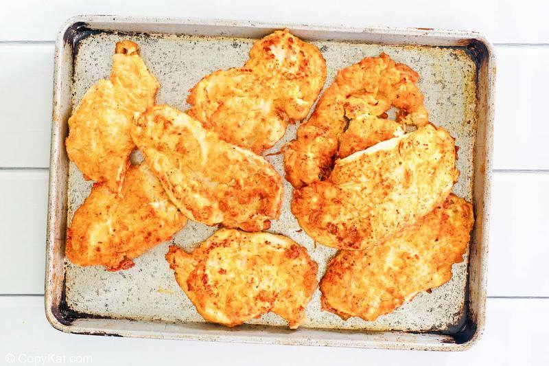 fried chicken cutlets on a baking sheet