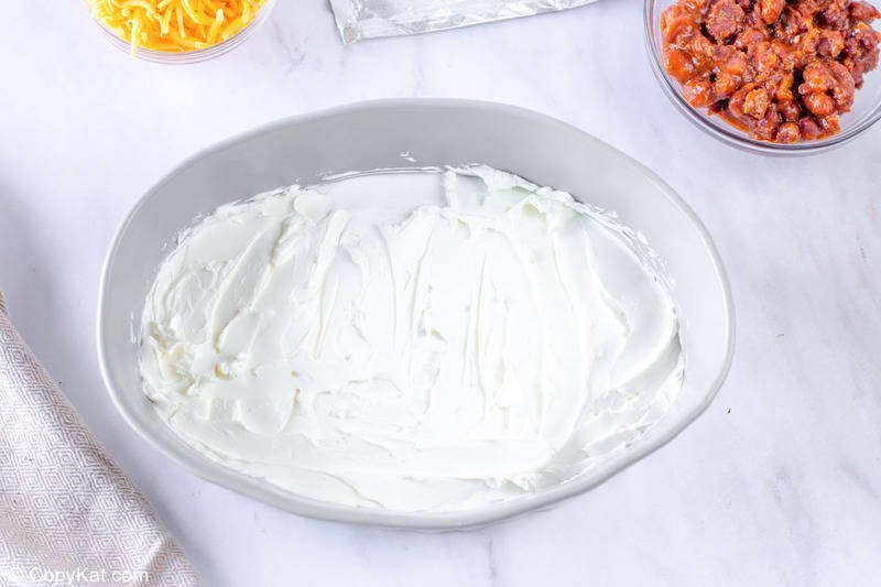 cream cheese spread in the bottom of a baking dish