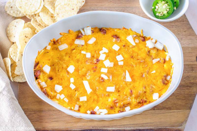 chili cheese dip, tortilla chips, and jalapeno pepper slices