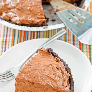 chocolate pudding pie in a pie plate and a slice on a plate