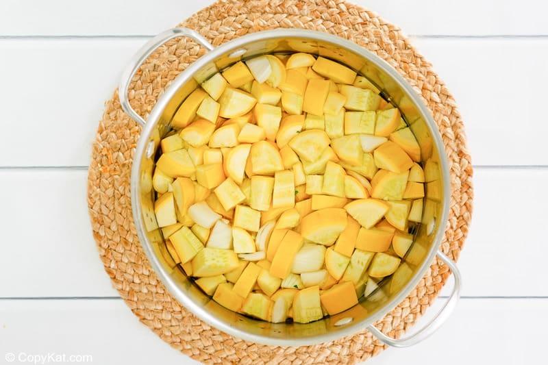 chopped yellow squash in a pan