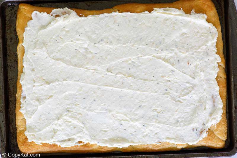 baked crescent roll pizza crust topped with cream cheese mixture