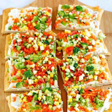 crescent roll veggie patch pizza on a cutting board