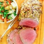eye of round roast, meat fork, and vegetables