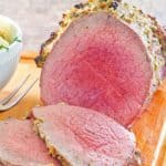 eye of round roast and slices on a cutting board