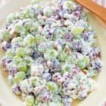 grape salad and salad tongs on a platter